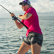 Famale angler fighting a fish