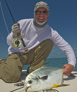 fly fishing flats for permit. Angler shows off his permit